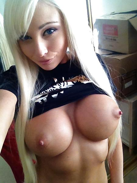 Busty blonde bimbo with massive fake tits takes a work selfie