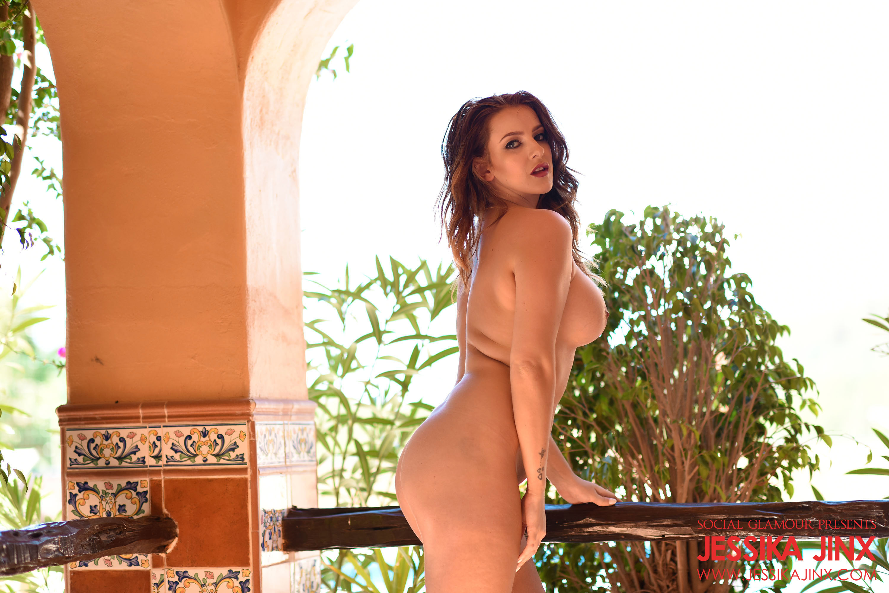 Curvy glamour model Jessika Jinx removes her silk panties and goes full nude